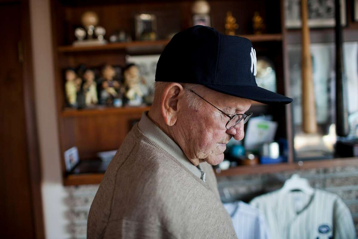 Former Major League catcher Charlie Silvera in a moment while recollecting stories from his time in the Majors at his home in Millbrae, Calif. on Tuesday, Oct. 11, 2011. A San Francisco Native, Silvera played on the Yankees' championship team in the 50's as a catcher alongside Yogi Berra and Elston Howard and remains active today as a scout.