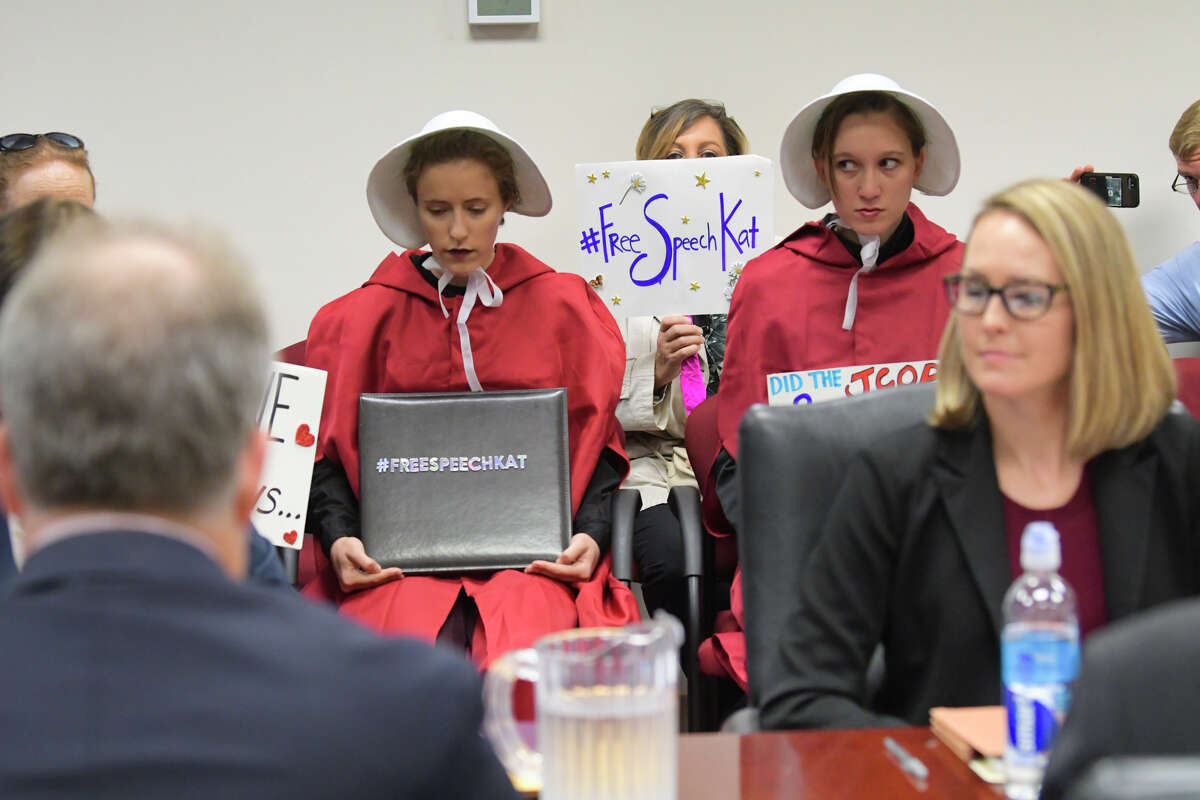 Two women dressed as characters from The Handmaid's Tale and supporters of Kat Sullivan, a former Emma Willard student and alleged rape victim, attend a meeting of the New York State Joint Commission on Public Ethics on Tuesday, Sept. 10, 2019, in Albany, N.Y. JCOPE is pursuing Sullivan for alleged violations of lobbying regulations. (Paul Buckowski/Times)