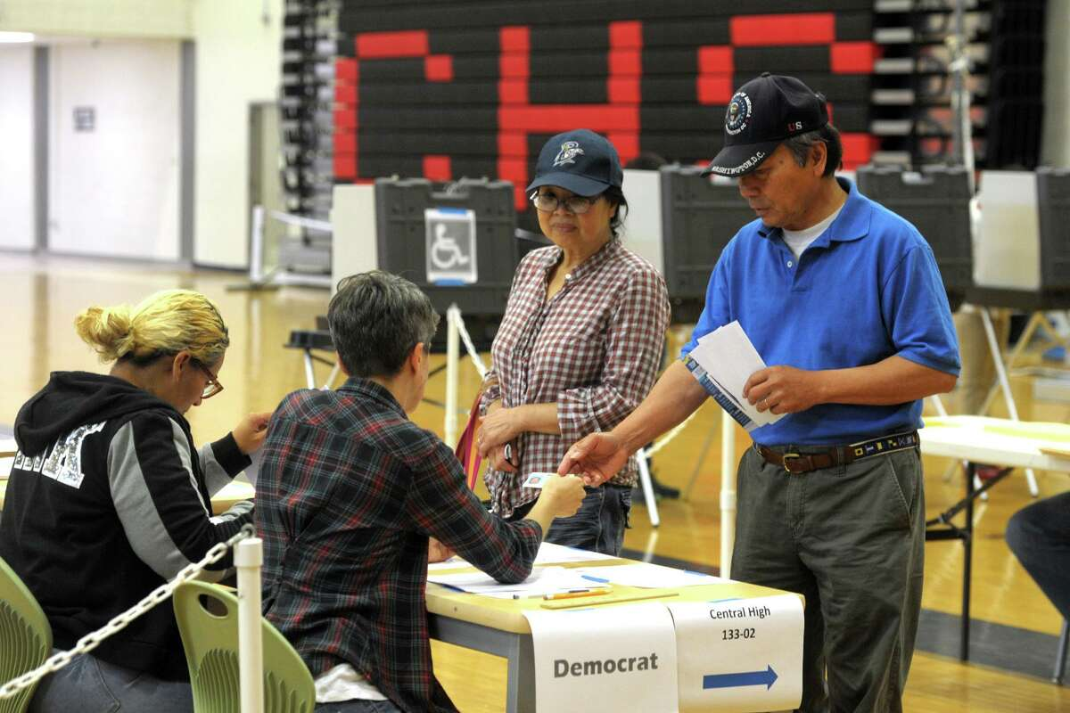 Voters went to the polls in last month's primary. Pictured here are Bridgeport residents at the polling location at Central High School.