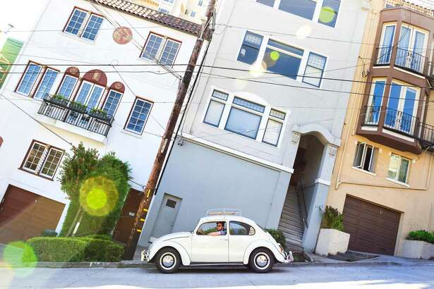 Ben Ramirez drives around San Francisco (hills and all) in his 1966 VW Beetle. Yes, it's a manual.