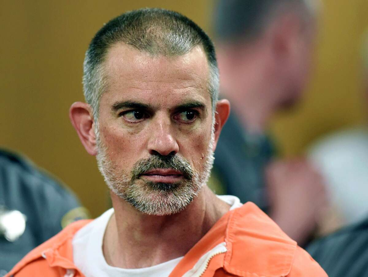FILE - In this June 3, 2019 file photo, Fotis Dulos stands during arraignment on charges of tampering with or fabricating physical evidence and first-degree hindering prosecution at Norwalk Superior Court in Norwalk, Conn. Dulos was arrested again on Wednesday, Sept. 4, 2019, at his Farmington home in connection with the disappearance of his estranged wife Jennifer Dulos, the mother of five who has been missing since May 24. (Tyler Sizemore/Hearst Connecticut Media via AP, Pool, File)
