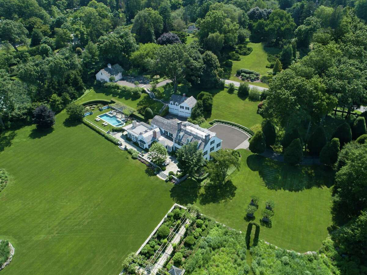 The Belle Haven beauty at 23 Smith Road presides over more than 5 acres of land, waterfront on Greenwich Harbor. The estate-the former home of Oliver Mead-is listed by Houlihan Lawrence for $39.5 million.
