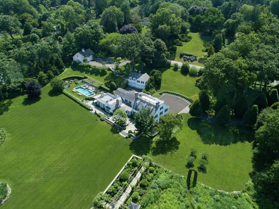The Belle Haven beauty at 23 Smith Road presides over more than 5 acres of land, waterfront on Greenwich Harbor. The estate—the former home of Oliver Mead—is listed by Houlihan Lawrence for $39.5 million. Photo: Contributed Photo