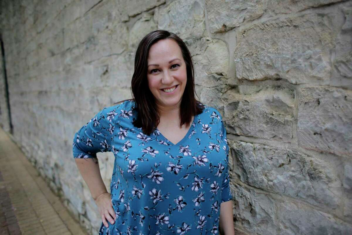 In this July 1, 2019 photo, Air Force veteran MJ Hegar poses for a photo in Round Rock, Texas. Hegar is the most significant challenger so far to Republican Sen. John Cornyn and has already raised more than $1 million. (AP Photo/Eric Gay)