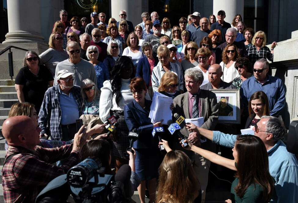 Attorney Victoria Esposito, advocacy coordinator for the Legal Aid Society of Northeastern New York, center, speaks to the media after filing a lawsuit on behalf of St. Clare's pensioners against the Roman Catholic Diocese of Albany on Tuesday, Sept. 10, 2019, at the Schenectady County Judicial Building in Schenectady, N.Y. She was joined by St. Clare's pensioners and family members. (Will Waldron/Times Union)