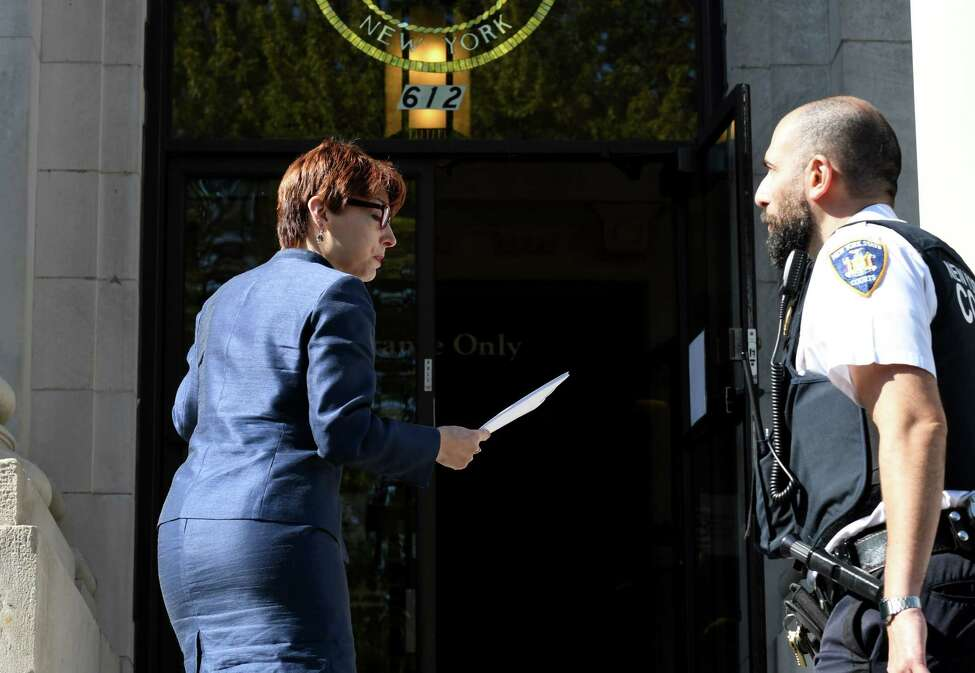 Attorney Victoria Esposito, advocacy coordinator for the Legal Aid Society of Northeastern New York, enters the Schenectady County Judicial Building to file legal papers on behalf of St. Clare's pensioners against the Roman Catholic Diocese of Albany on Tuesday, Sept. 10, 2019, in Schenectady, N.Y. (Will Waldron/Times Union)