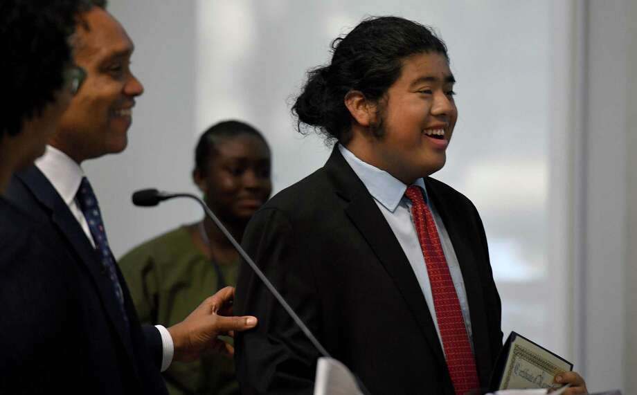 Angel Henriquez smiles after he received a Right Direction award from D.C. Attorney General Karl Racine. Henriquez was one of more than two dozen young people honored for overcoming challenges and making positive change in their communities. Photo: Washington Post Photo By Michael S. Williamson / The Washington Post