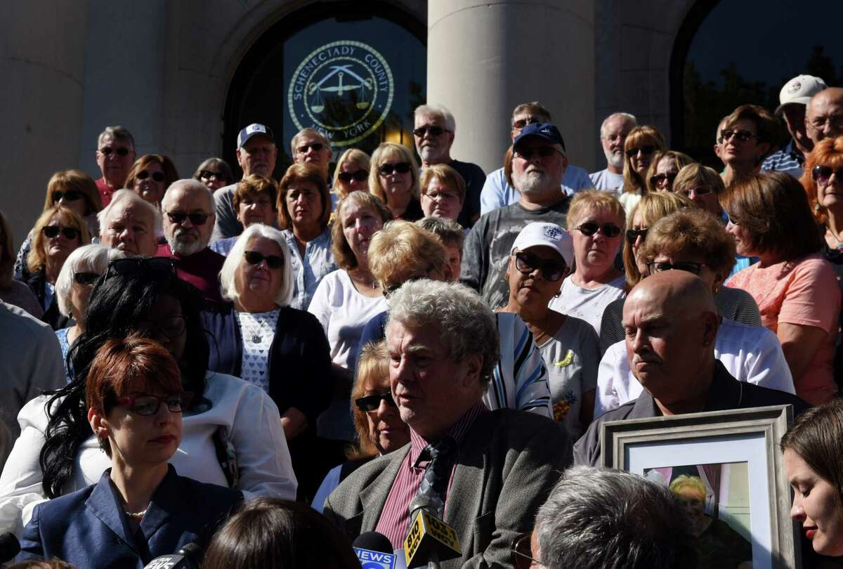 Attorneys David Pratt, law professor at Albany Law School, center, and Victoria Esposito, advocacy coordinator for Legal Aid Society of Northeastern New York, left, speak to the media after filing a lawsuit on behalf of St. Clare's pensioners against the Roman Catholic Diocese of Albany on Tuesday, Sept. 10, 2019, at the Schenectady County Judicial Building in Schenectady, N.Y. They were joined by St. Clare's pensioners and family members. (Will Waldron/Times Union)