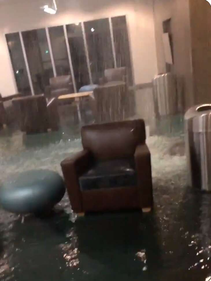 A video shared on Twitter by student Tony Alebesun shows water gushing from the ceiling to the floor and students standing outside the building.