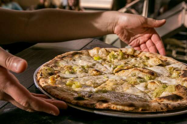 """The """"King Thistle"""" pizza about to be served at Eastend Pizza in Alameda, Calif., on Wednesday, May 15th, 2014."""