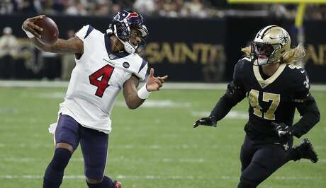 Houston Texans quarterback Deshaun Watson (4) runs to a first down past New Orleans Saints middle linebacker Alex Anzalone (47) during the third quarter of an NFL  football game at the Mercedes-Benz Superdome on Monday, Sept. 9, 2019, in New Orleans.