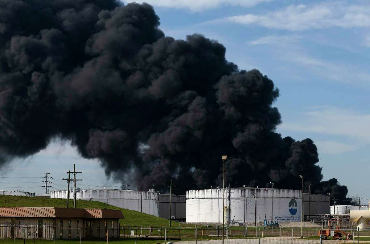 Firefighters battle to extinguish a petrochemical fire at intercontinental Terminals Company Monday, March 18, 2019, in Deer Park, Texas. The fire started Sunday and grew from two to eight tanks overnight.