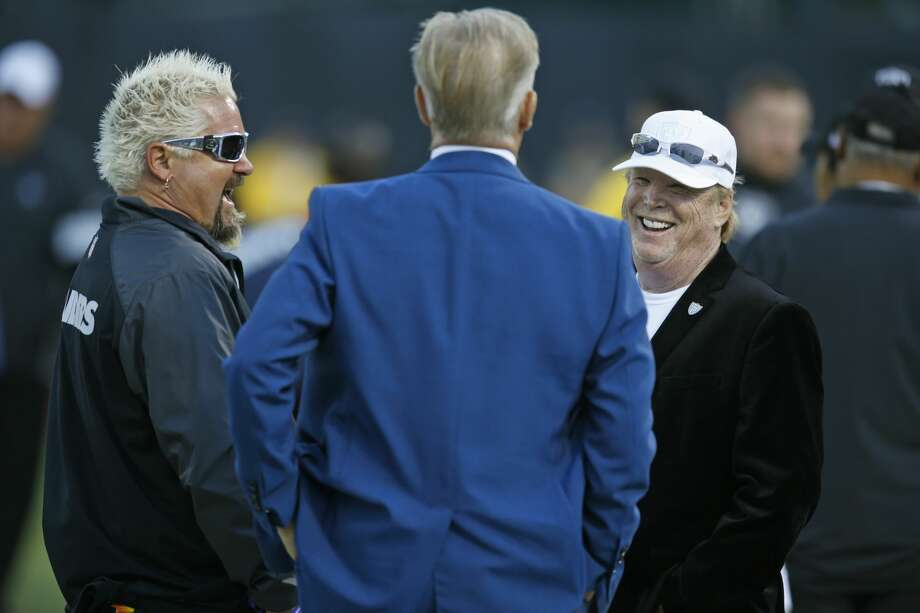 From left, Guy Fieri, Denver Broncos President John Elway and Oakland Raiders owner Mark Davis talk before the start of an NFL football game Monday, Sept. 9, 2019, in Oakland, Calif. Photo: D. Ross Cameron/AP