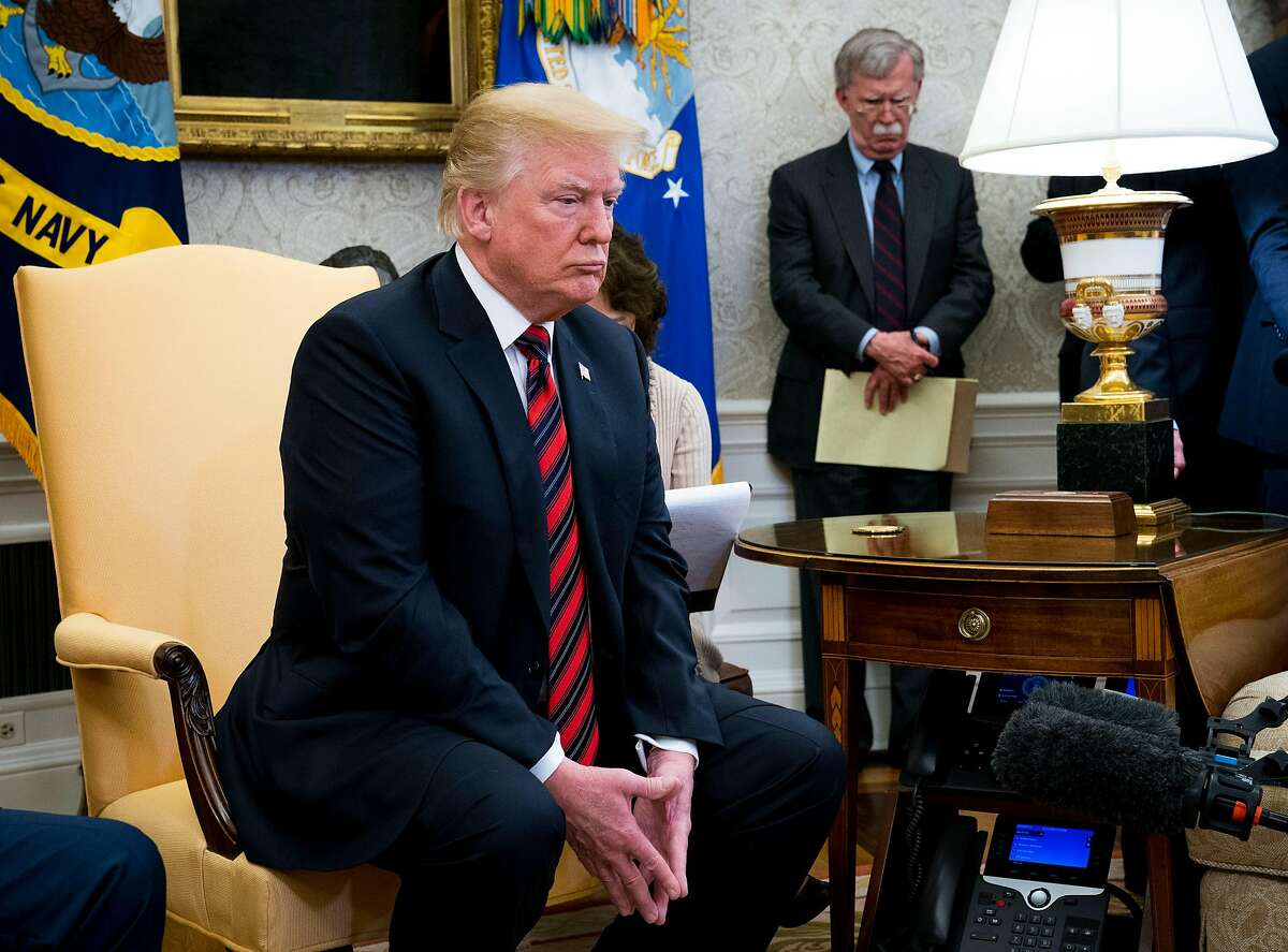 FILE -- John Bolton, President Donald Trump's national security adviser, looks on as Trump meets with President Moon Jae-in of South Korea in the Oval Office on May 22, 2018. Trump fired Bolton, his third national security adviser, on Tuesday, Sept. 10, 2019, amid fundamental disagreements over how to handle major foreign policy challenges like Iran, North Korea and Afghanistan. (Doug Mills/The New York Times)