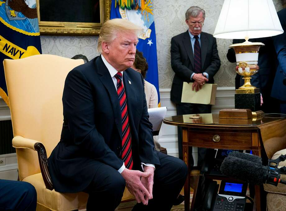 FILE -- John Bolton, President Donald Trump's national security adviser, looks on as Trump meets with President Moon Jae-in of South Korea in the Oval Office on May 22, 2018. Trump fired Bolton, his third national security adviser, on Tuesday, Sept. 10, 2019, amid fundamental disagreements over how to handle major foreign policy challenges like Iran, North Korea and Afghanistan. (Doug Mills/The New York Times) Photo: DOUG MILLS;Doug Mills / New York Times