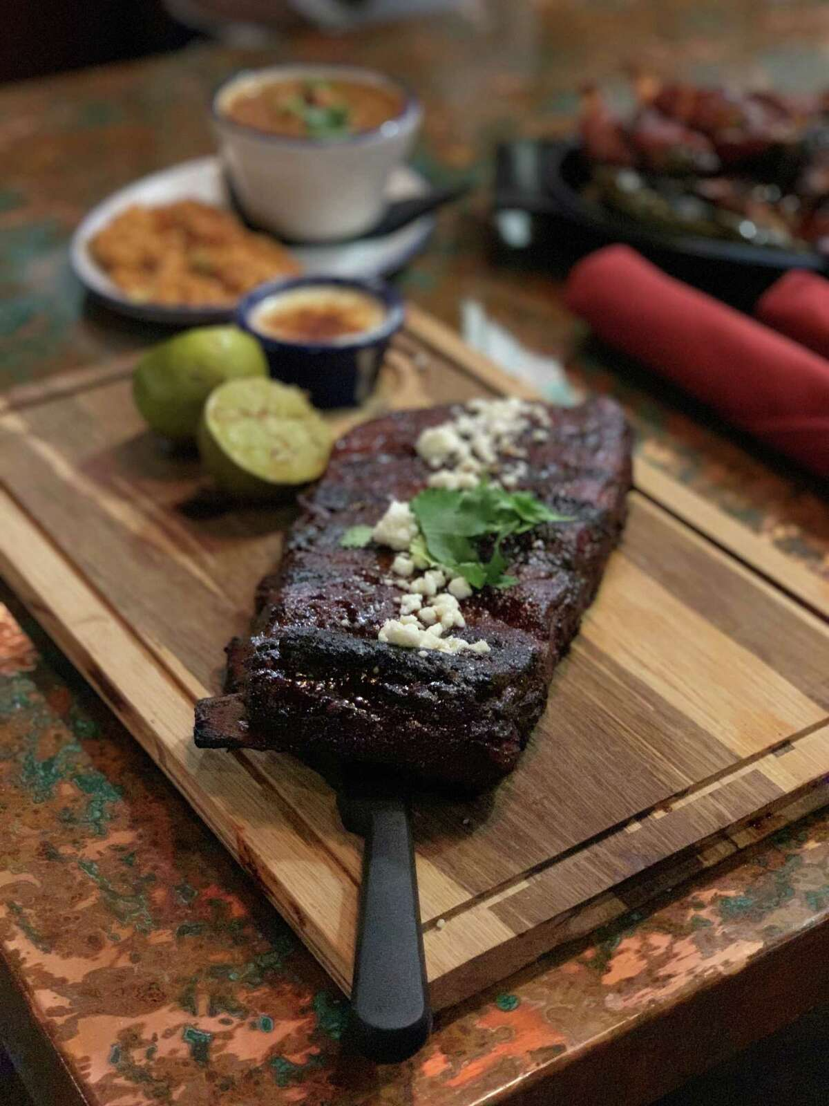 Candente, a new Tex-Mex restaurant with smoked and live-fire meats, is opening Sept. 16 at 4306 Yoakum in Montrose. Shown: smoked pork ribs.