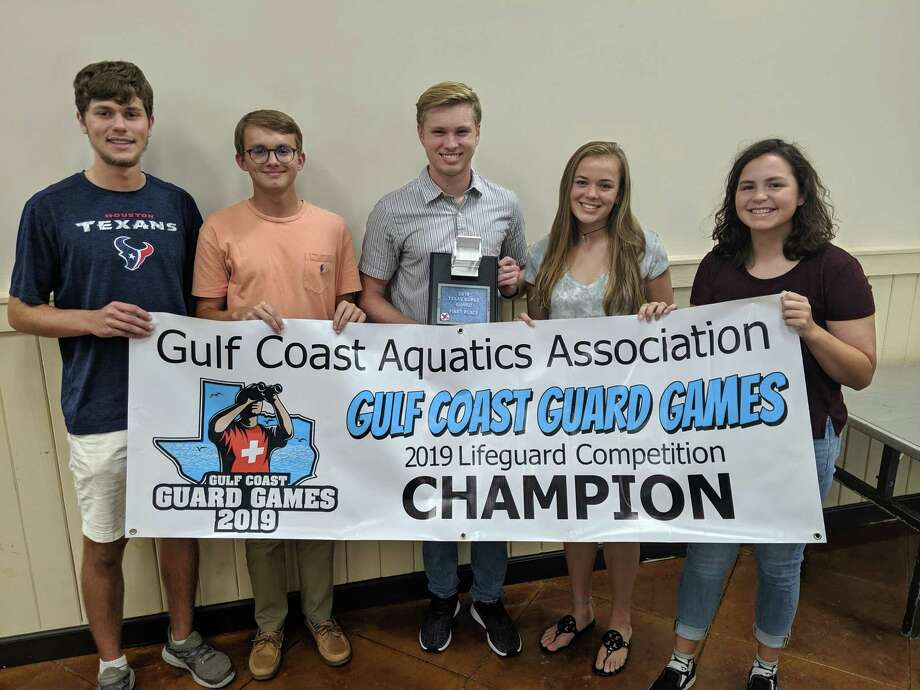 Anthony Weeks, left, Wyatt Cade, Zachary Jilg, Lauren Barnes, and Emma Cade, members of The Woodlands Township lifeguard team. Photo: Jamie Swinnerton