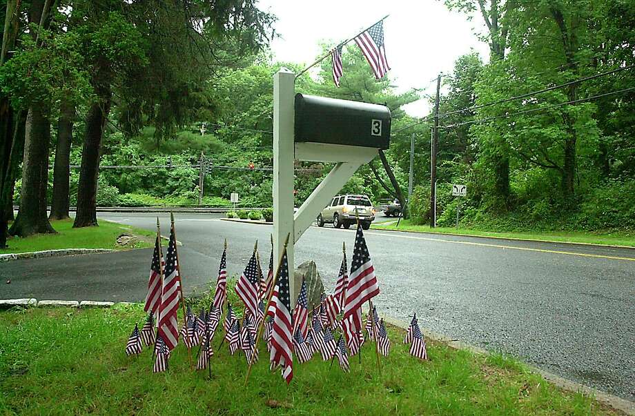Greenwich 14 Sep 2001 - American flags surround a mailbox on Hillside Road.  Photo/Mel Greer  COLOR Photo: GT