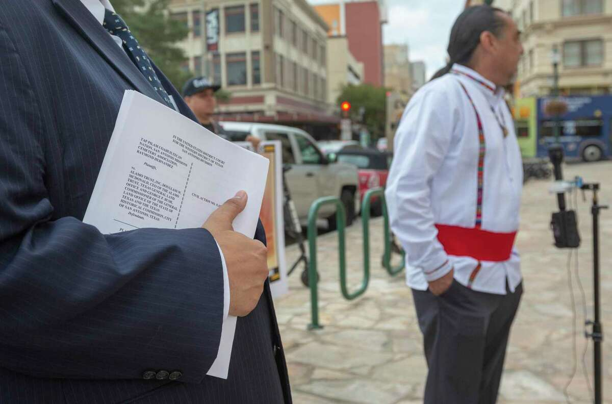 Attorney Art Martinez de Vara holds a copy of the federal lawsuit he filed on behalf of the Tap Pilam Coahiltecan Nation seeking to ensure the tribe will be able to participate in the reburial of human remains unearthed by renovations at the Alamo.