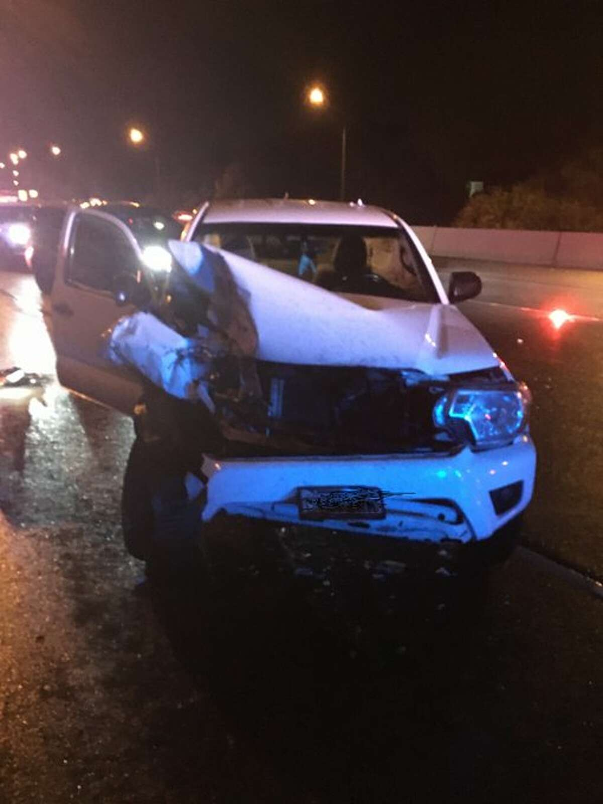 Damage to the driver's vehicle after it crashed into the back of a trooper's vehicle, pulled over in response to a three-vehicle crash on northbound I-405 in Bothell on Saturday.
