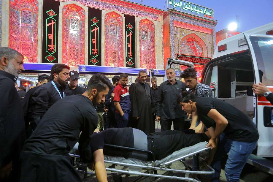An injured man is placed in an ambulance after a walkway collapsed in the holy city of Karbala, Iraq. Photo: Anmar Khalil / Associated Press