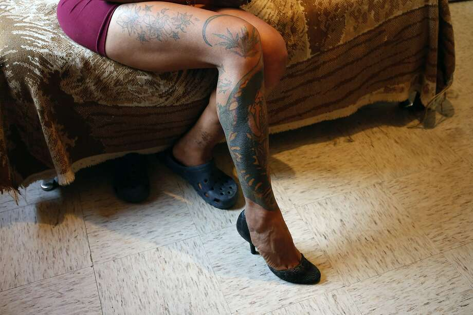 In this Aug. 17, 2019 photo, trans rights activist Kenya Cuevas sits on the edge of her bed to show off the tattoos on her right leg, in her bedroom in Chalco, Mexico. While the government of Andres Mauel López Obrador has publicly sided with LGBTQ rights in its discourse, it's not clear what protections may be being put in place or envisioned to combat violence against the community.(AP Photo/Ginnette Riquelme) Photo: Ginnette Riquelme / Associated Press