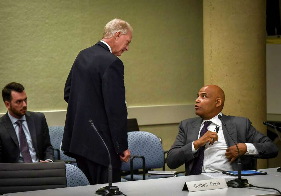 Jack Evans, left, chats with fellow board member Corbett Price on Evans's last day as chairman of the WMATA board on June, 27, 2019. Both have left the board. Photo: Washington Post Photo By Bill O'Leary. / The Washington Post