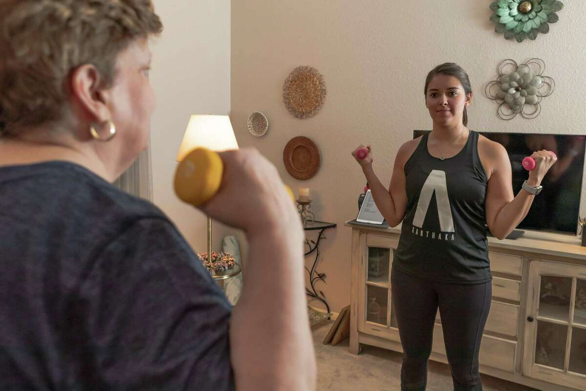 Bebe Pierce of Houston works out during her personal trainer session with April Brewer from Kanthaka, a Houston-based app that brings yoga instructors and personal trainers to your home Monday, Sep 9, 2019, in Houston.