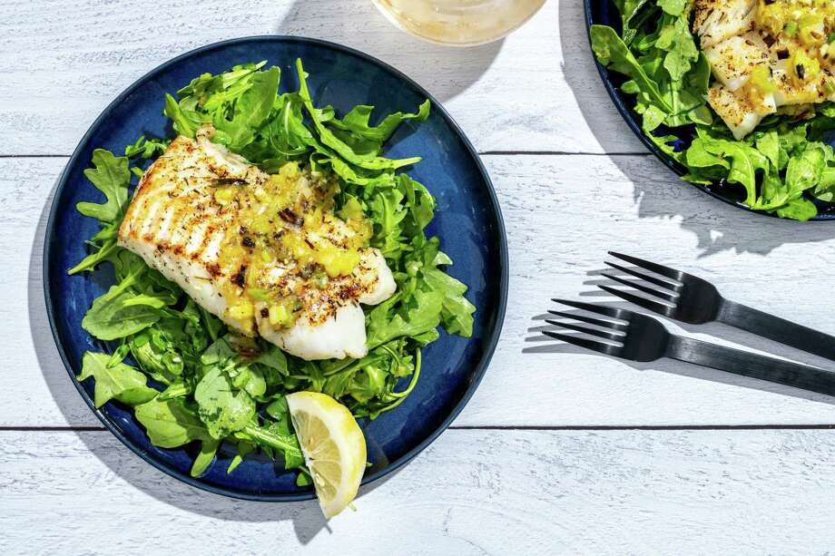 Cod with arugula and charred scallion vinaigrette. Photo: Photo By Laura Chase De Formigny For The Washington Post / Laura Chase de Formigny