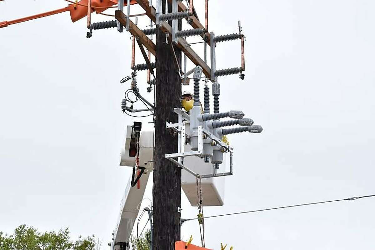 """This photograph from Entergy Texas, Inc., shows a working installing a device called a """"recloser,"""" which is used to help mitigate lower level power outages by creating what is called """"sectionalizing"""" of the electrical grid. Entergy officials are installing about 50 of the devices in their territory in Southeast Texas, including in The Woodlands."""