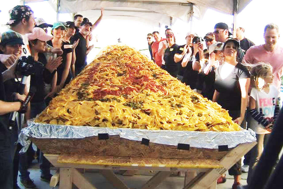 """World's Largest Nachos! Funded October 2016 """"I work with a company called Chirps that makes cricket tortilla chips to get people excited about eating bugs. We have 2000lbs of tortilla chips leftover from a client that over-ordered that will expire in December... unless we do something ridiculously cool with them like BUILD THE WORLD'S LARGEST SERVING OF NACHOS and invite the entire city of San Francisco to a giant bug nacho party."""" Photo: Awesome Foundation"""