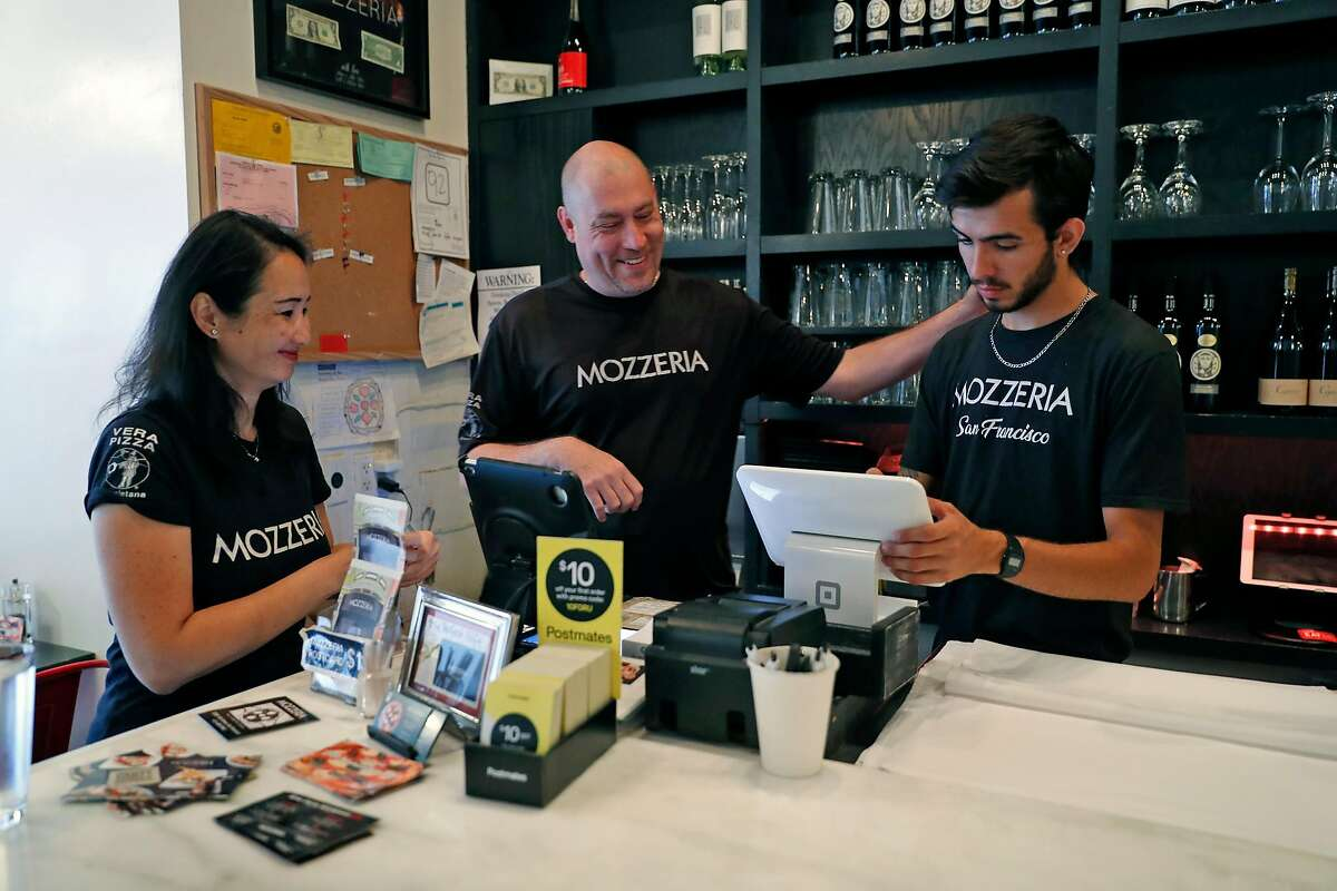 Mozzeria owners Melody and Russell Stein interact with server, Yordi Morales, at their pizza restaurant in San Francisco, Calif., on Sunday, September 8, 2019.