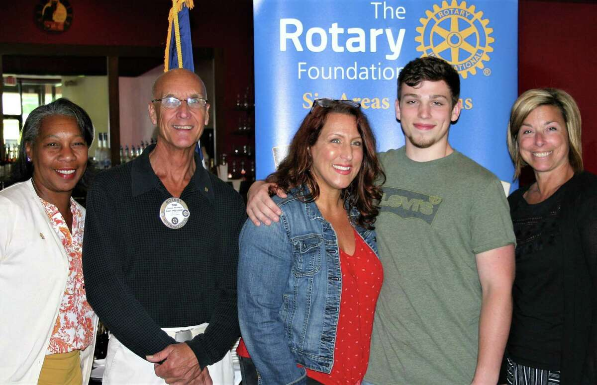 The Rotary Club of New Milford recently presented its June Student of the Month Award to Caleb Gaylord. Caleb is a youth and worship leader at his church, has volunteered with Relay for Life and traveled to Puerto Rico with his youth group to aide in relief efforts. He plays guitar and writes music, having won first place in regionals and advanced to the nationals this summer. Caleb will attend Nyack College in the fall, where he will major in intercultural and Biblical studies with a goal of mission work in impoverished countries. Caleb is shown above with, from left to right, Rotarians Cheyrisse Boone and Tom McSherry, Caleb's mom, Lisa Gaylord, and NMHS teacher Lisa Lee.