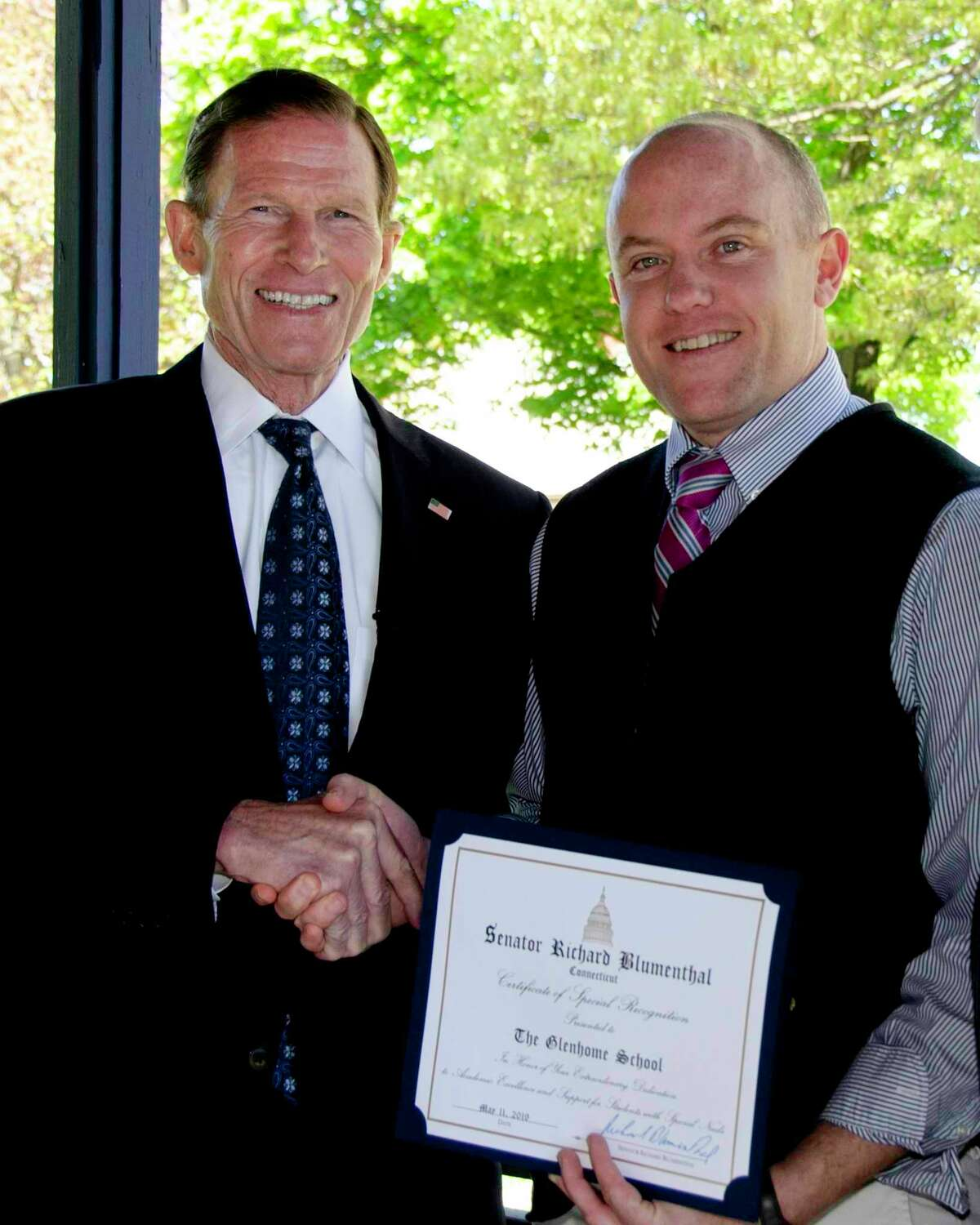 The Glenholme School in Washington was recently awarded a certificate of recognition for excellence in the field of special education by U.S. Sen. Richard Blumenthal. Above, Glenholme School Executive Director Noah Noyes, right, accepts the award on behalf of the school community.