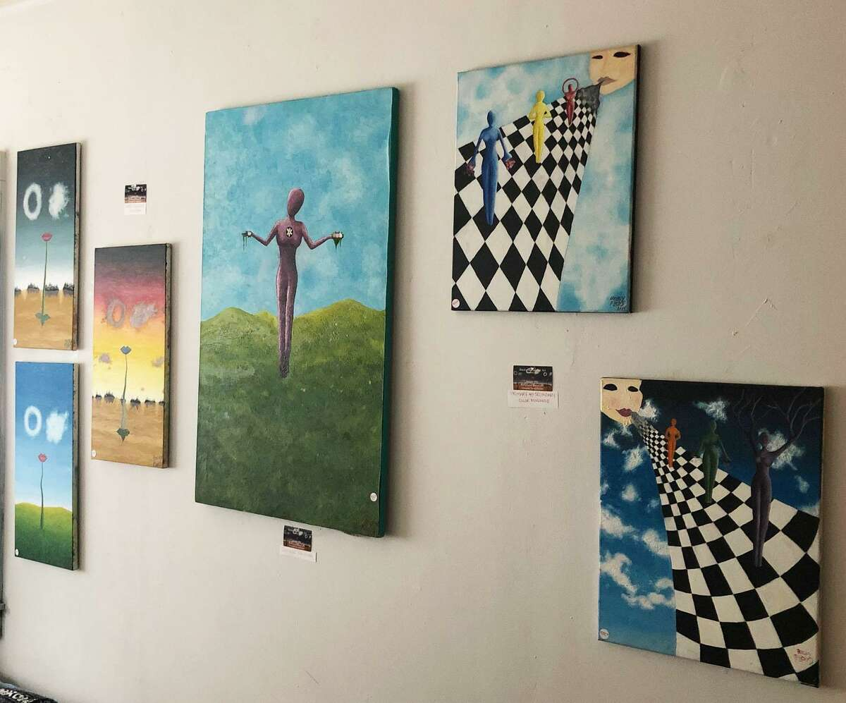 A workshop room doubles as an art gallery, where local artists' work is showcased at Enchanted Realms in New Milford.