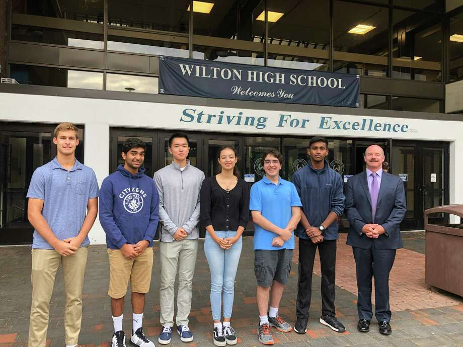National Merit semifinalists, from left, Maden Herve, Rishabh Raniwala, Jeffrey Huang, Ashleigh Coltman, Alexander Koutsoukos, Vignesh Subramanian and Wilton High School Principal Dr. Robert W. O'Donnell. Photo: Contributed Photo / Wilton High School / Wilton Bulletin Contributed