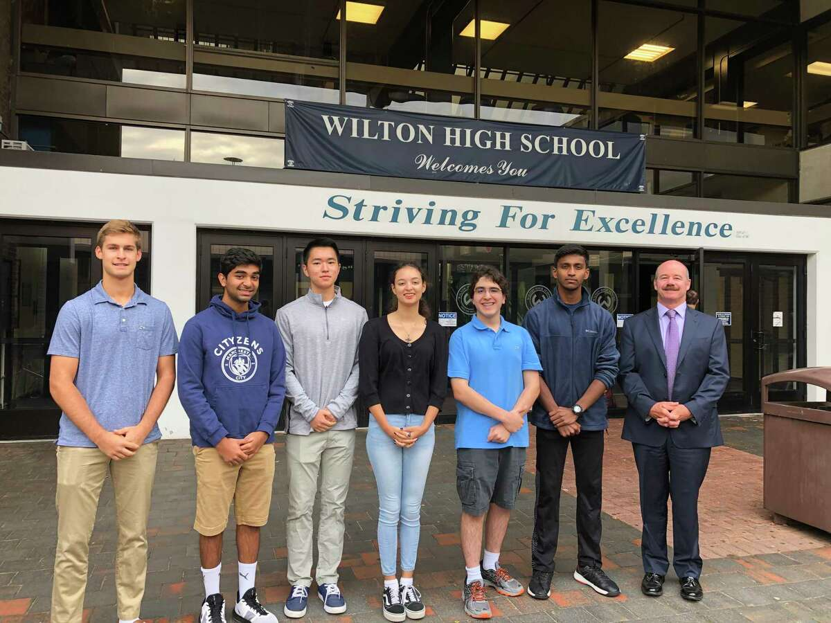 National Merit finalists, from left, Maden Herve, Rishabh Raniwala, Jeffrey Huang, Ashleigh Coltman, Alexander Koutsoukos, Vignesh Subramanian stand with Wilton High School Principal Dr. Robert. W. O'Donnell when they were named semifinalists in September.