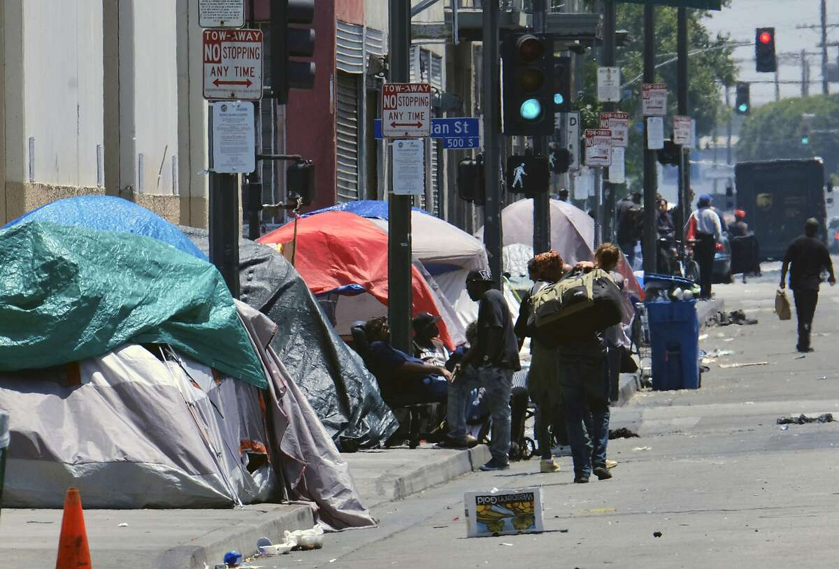 Tents housing homeless line a street in downtown Los Angeles.