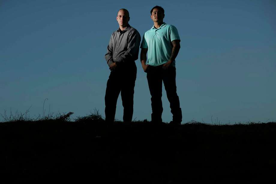 Ryan Clay, left, and Rocco DePrimo, right, former members of India Company, 3rd Battalion, 6th Marines, pose together for a photograph in Statesville, N.C. Clay and DePrimo served together in Afghanistan, and now, almost a decade later, live down the street from each other. Photo: Photo For The Washington Post By Eamon Queeney / Eamon Queeney