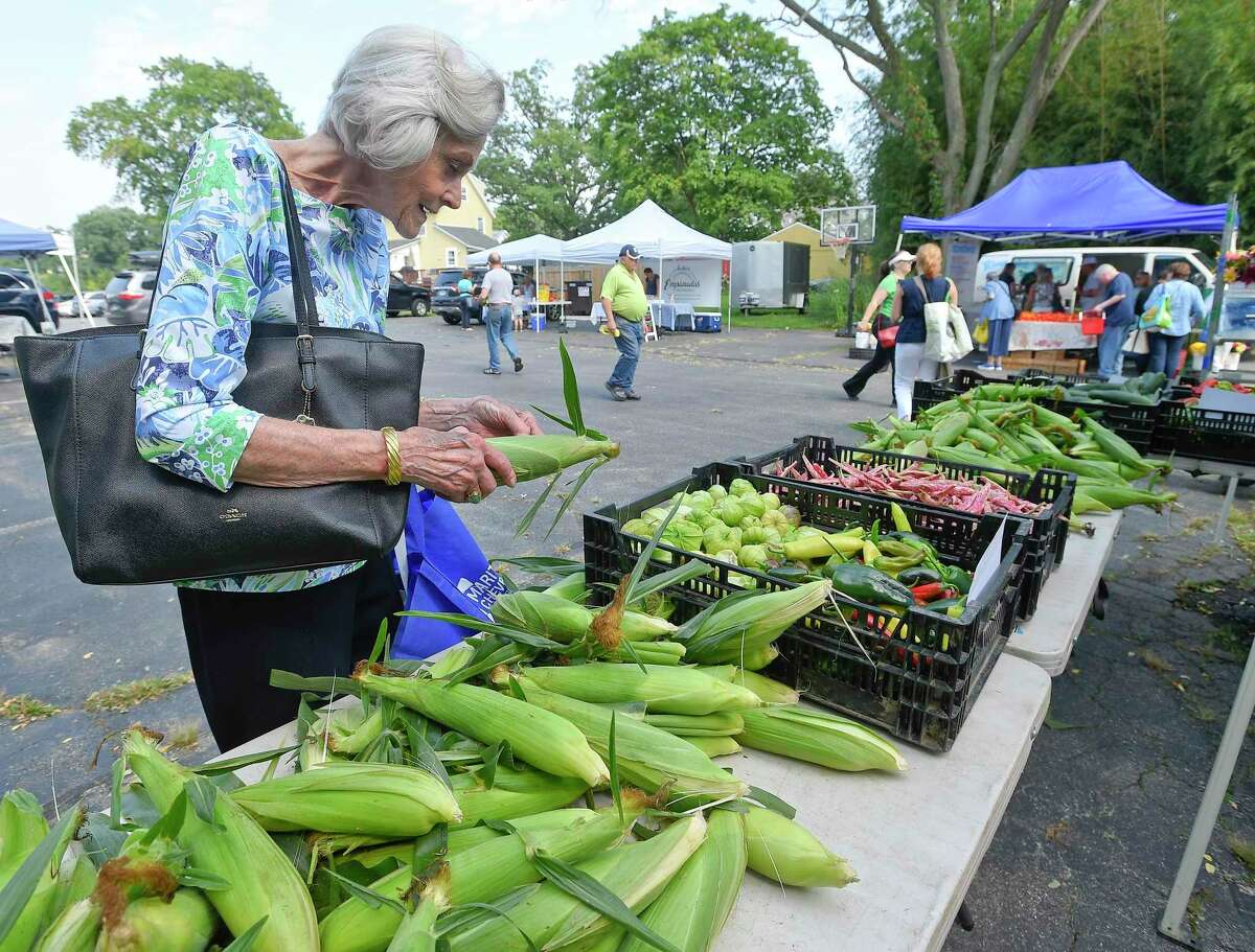 Janice Doty of Greenwich checks the freshness white corn, as she picks out several ears from Smith Acres Farm, one of several vendors set up at the Old Greenwich Farmers Market on Sept. 4, 2019. The farmers market is held every Wednesday, Rain or Shine, from 2:30 to 6 p.m. in the parking lot at Living Hope Community Church at 38 West End Avenue in Old Greenwich.
