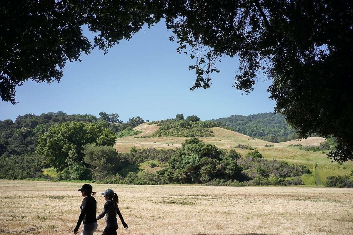 Two women walk through Rancho San Antonio in Cupertino