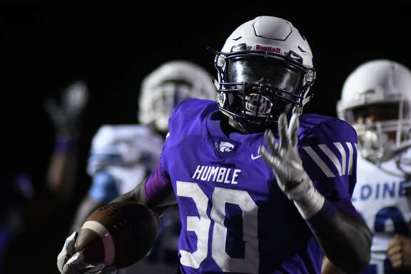 Humble sophomore running back X'zavier Sydney (30) outruns a pair of Aldine defenders to the end zone for one of his 4th quarter touchdowns during their non-district matchup at Turner Stadium in Humble on Sept. 7, 2019.