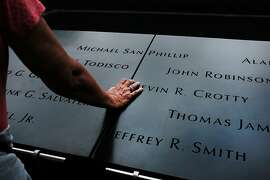 NEW YORK, NEW YORK - SEPTEMBER 10: People pause at the World Trade Center Memorial in lower Manhattan on September 10, 2019 in New York City. New York City is preparing to commemorate the 18th anniversary of the attacks on the World Trade Center in which 2,996 people were killed and over 6000 were injured.  (Photo by Spencer Platt/Getty Images)