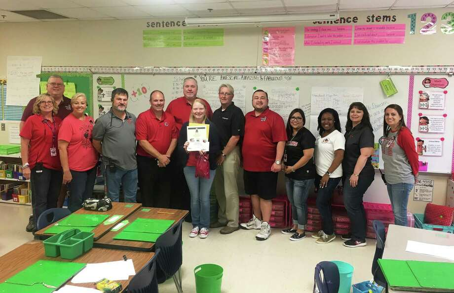 Administrators in Cleveland ISD surprised Sheila Dawson as the Teacher of the Week for the district. Gathered to celebrate her award are Southside Principal Janie Snyder, Jeff McClain with KORG-LP, Southside Asst. Principal Kelli Jimenez, Southside Asst. Principal Dennis Jamison, CISD Asst. Superintendent of HR Dr. Nathan Boughton, CISD Superintendent of Schools Chris Trotter, Dawson, Bruce Martin with DeMontrond Ford, Waldo Rodas with KORG-LP, Asst. Superintendent of Curriculum and Instruction Maria Silva, LaChandra Ryan with Health Center Southeast Texas, CISD CFO Karen Billingsley, and Southside Asst. Principal Allie Wilkins. Photo: Submitted