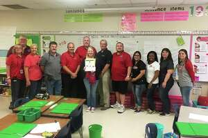 Administrators in Cleveland ISD surprised Sheila Dawson as the Teacher of the Week for the district. Gathered to celebrate her award are Southside Principal Janie Snyder, Jeff McClain with KORG-LP, Southside Asst. Principal Kelli Jimenez, Southside Asst. Principal Dennis Jamison, CISD Asst. Superintendent of HR Dr. Nathan Boughton, CISD Superintendent of Schools Chris Trotter, Dawson, Bruce Martin with DeMontrond Ford, Waldo Rodas with KORG-LP, Asst. Superintendent of Curriculum and Instruction Maria Silva, LaChandra Ryan with Health Center Southeast Texas, CISD CFO Karen Billingsley, and Southside Asst. Principal Allie Wilkins.