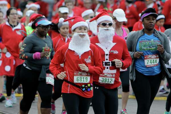The Santa Hustle 5K and Half Marathon takes place at Moody Gardens in Galveston.