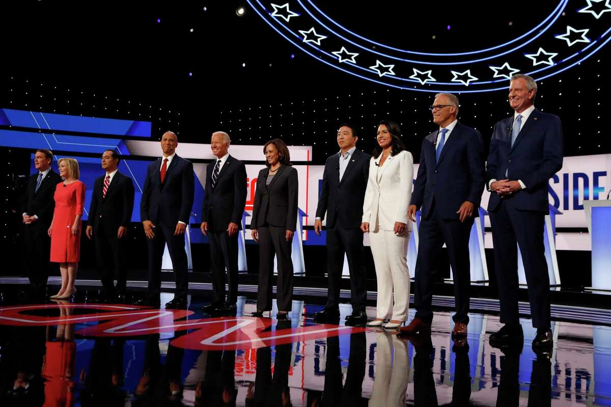 From left, Sen. Michael Bennet, D-Colo., Sen. Kirsten Gillibrand, D-N.Y., former Housing and Urban Development Secretary Julian Castro, Sen. Cory Booker, D-N.J., former Vice President Joe Biden, Sen. Kamala Harris, D-Calif., Andrew Yang, Rep. Tulsi Gabbard, D-Hawaii, Washington Gov. Jay Inslee and New York City Mayor Bill de Blasio are introduced before the second of two Democratic presidential primary debates hosted by CNN Wednesday, July 31, 2019, in the Fox Theatre in Detroit. (AP Photo/Carlos Osorio)