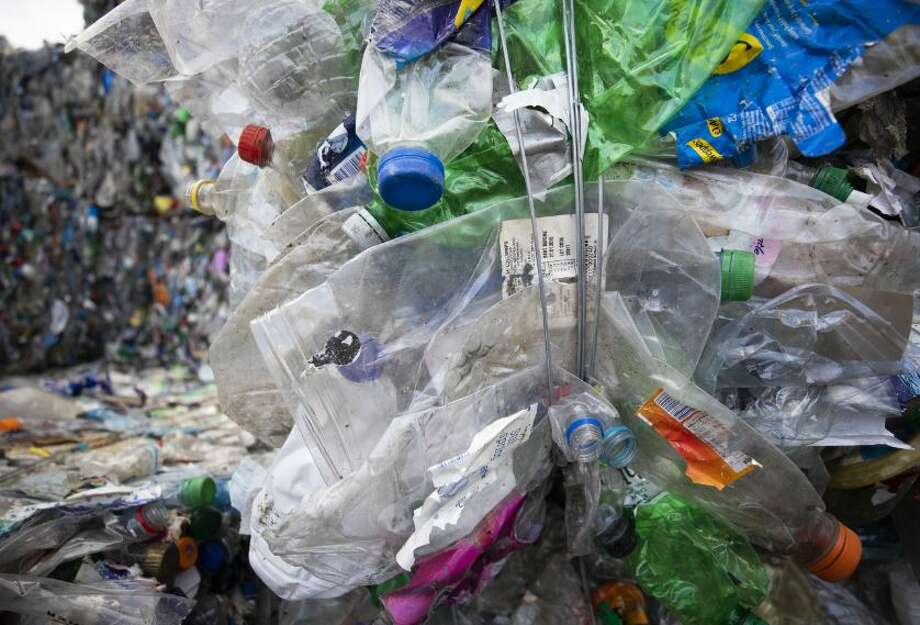 Crushed plastic bottles and containers sit bound in a bale ready to be recycled at a 4PET Recycling BV waste recycling center in Duiven, Netherlands, on Thursday, Aug. 23, 2018. Single-use plastic is increasingly coming under fire as debris flows into the world's oceans, rivers and lakes, and major companies such as McDonald's Corp. and Kraft Heinz Co. are trying to increase recycling and reduce waste. Photo: Jasper Juinen/Bloomberg