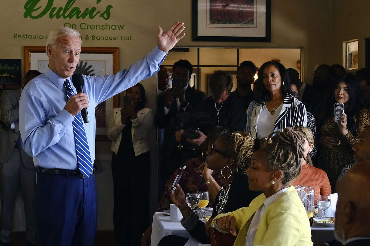 FILE - In this July 18, 2019, file photo, Democratic presidential candidate former Vice President Joe Biden speaks to community faith leaders after serving breakfast during a visit to Dulan's Soul Food on Crenshaw in Los Angeles. More than traditional markers of electability like name recognition, fundraising ability or charisma, the path to the Democratic nomination runs through black voters. (AP Photo/Richard Vogel, File)