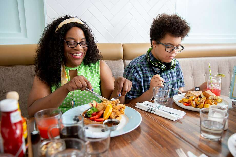 From left: Robin Wilson-Beattie with her son Alan Kai, 14, at Lapisara Eatery on Friday, Aug. 2, 2019, in San Francisco, Calif. Photo: Santiago Mejia / The Chronicle